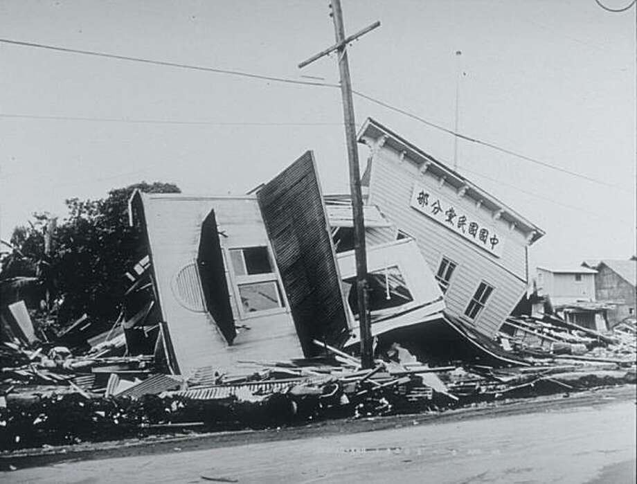 The 1946 tsunami generated by  an earthquake in the Aleutian Islands destroyed this Hilo clubhouse, photographed by the U.S. Army Corps of Engineers,  and every house on the main street facing Hilo Bay. Photo: NOAA/NGDC Natural Hazards Photo