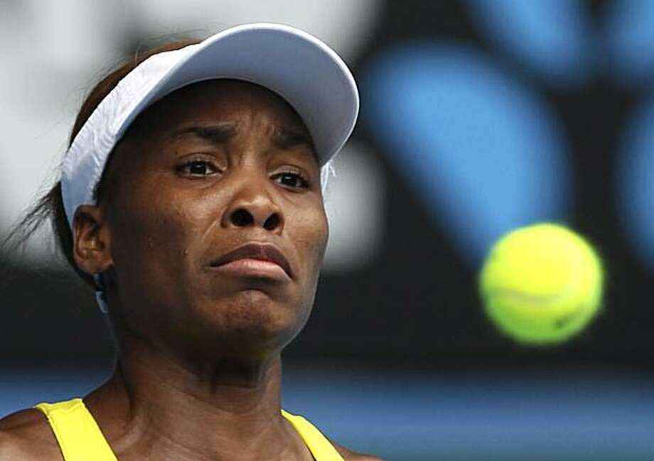 Venus Williams of the United States eyes on the ball as she plays Li Na of China during their Women's singles quarterfinal match at the Australian Open tennis championship in Melbourne, Australia, Wednesday Jan. 27, 2010. Photo: Rick Rycroft, AP