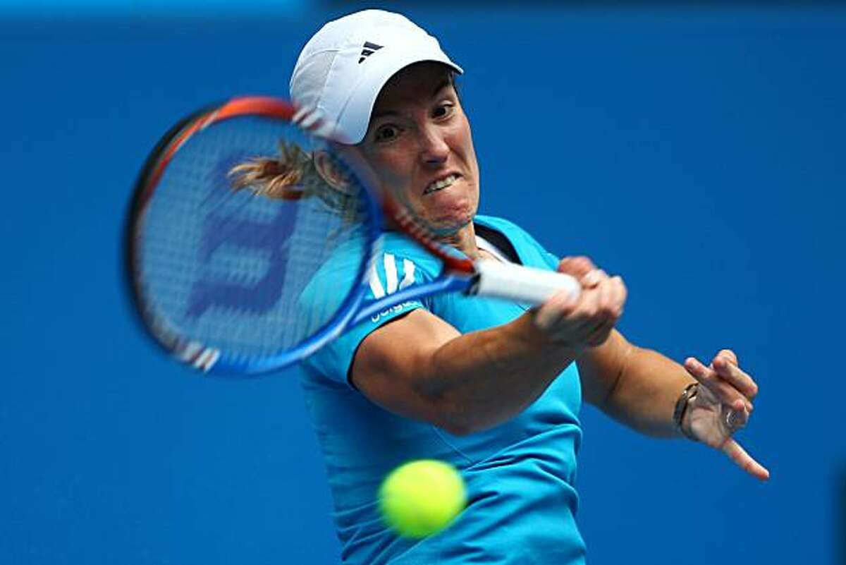 MELBOURNE, AUSTRALIA - JANUARY 22: Justine Henin of Belgium plays a forehand in her third round match against Alisa Kleybanova of Russia during day five of the 2010 Australian Open at Melbourne Park on January 22, 2010 in Melbourne, Australia.