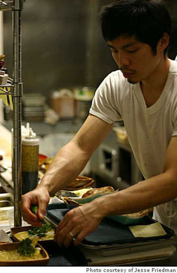 Anthony Myint, of Mission Street Food, prepares dishes in the Lung Shan kitchen. Photo: Photo Courtesy Of Jesse Friedman