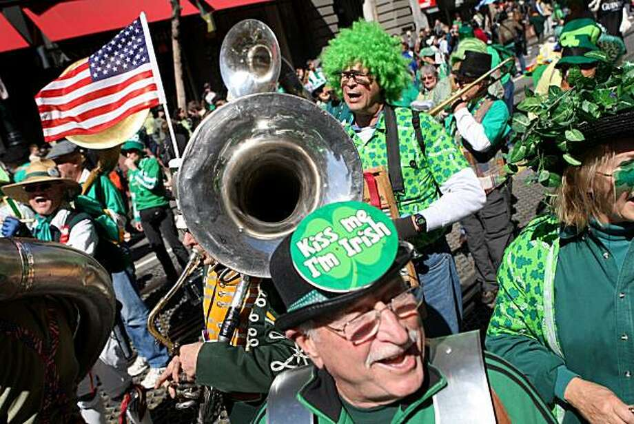 Members of the Los Trancos Woods Community Marching Band walk along Market Street during the 159th annual St. Patrick's Day Parade in San Francisco on Saturday. Photo: Jana Asenbrennerova, The Chronicle