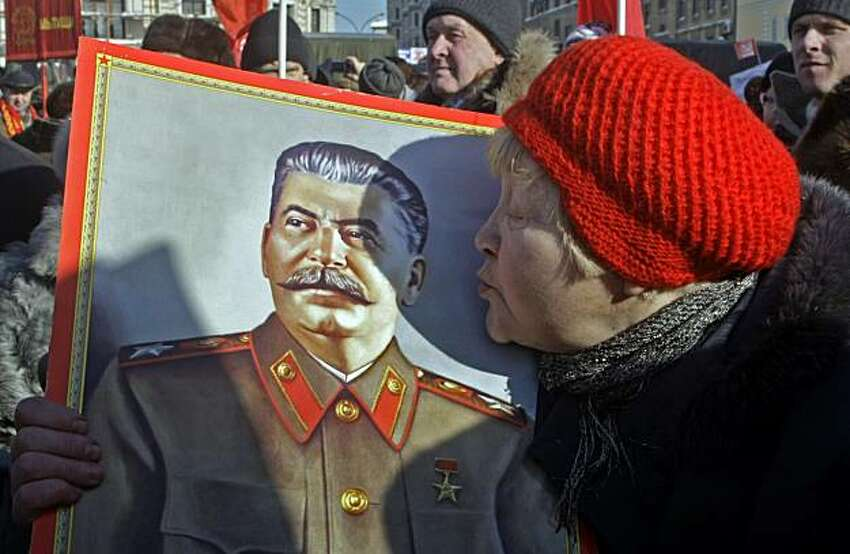 A women kisses a portrait of the Soviet dictator Josef Stalin, as Russian communists and their supporters hold a rally to mark Defenders of the Fatherland Day in Moscow, Tuesday, Feb. 23, 2010. About 2,000 communists and their supporters, mostly elderly people, held an authorized rally in downtown Moscow. The Defenders of the Fatherland Day, celebrated in Russia on Feb. 23, honors the nation's military and is a nationwide holiday.