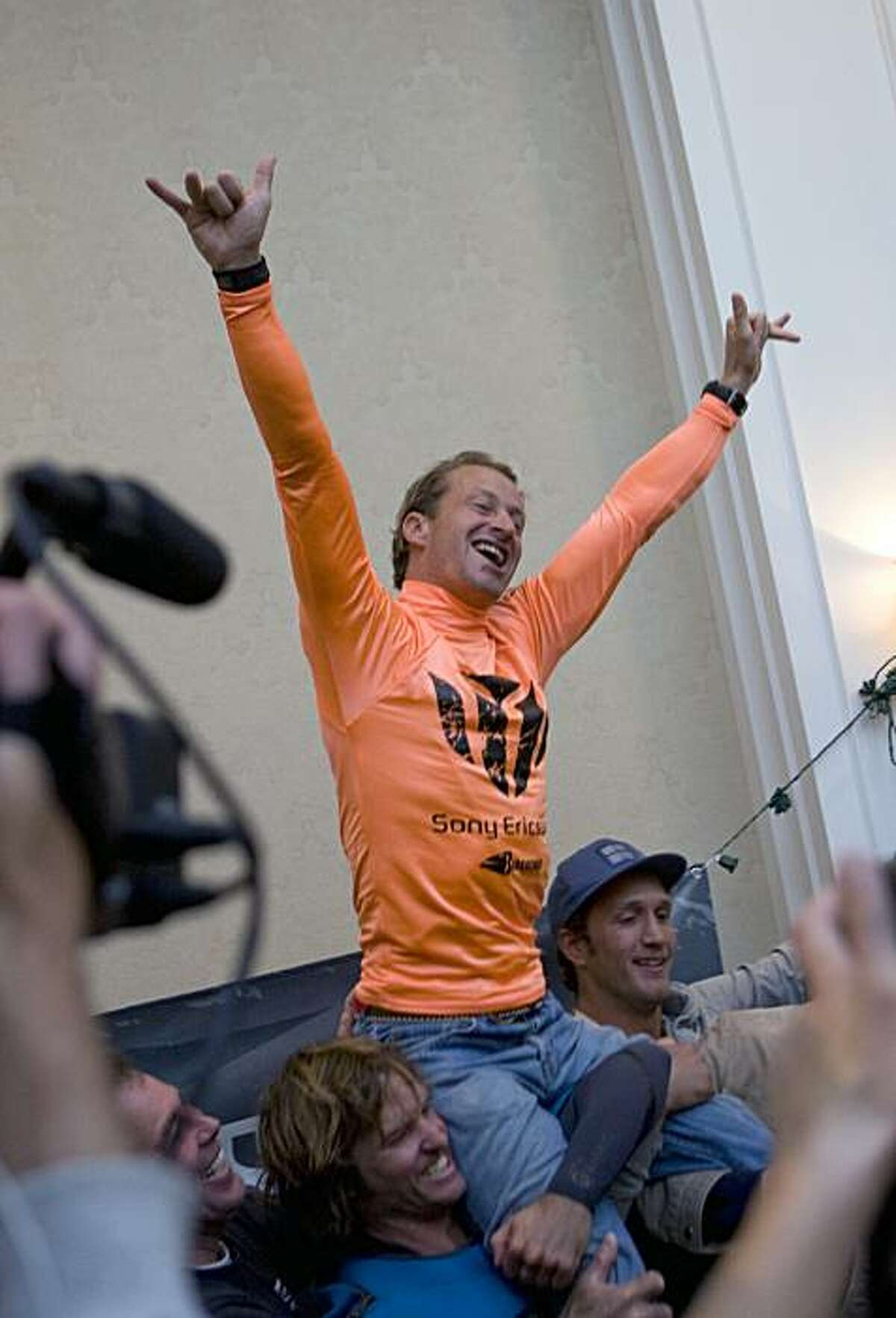 South African surfer Chris Bertish is hoisted onto fellow surfers shoulders before accepting first place in the Mavericks Surf Contest Surfers in Half Moon Bay, Calif. on Saturday, Feb. 13, 2010.