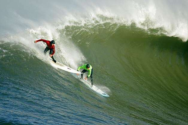 Evan Slater, left, and Grant Baker, right, try to catch a wave in the first heat. Surfers from around the globe braved the 50-foot-high swells at Mavericks Surf Contest in Half Moon Bay, Calif., on Saturday, February 13, 2010. Chris Bertish of South Africa was selected the winner. Photo: Carlos Avila Gonzalez, The Chronicle