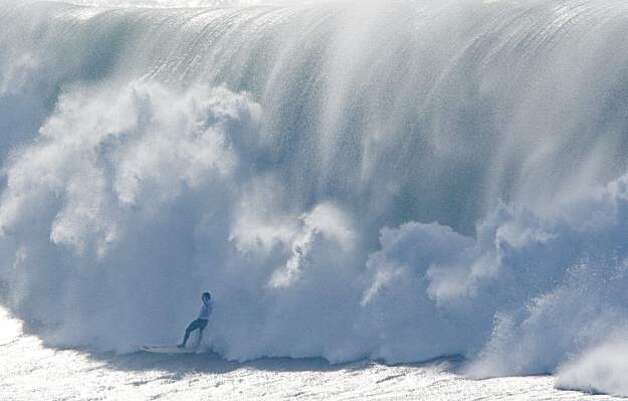 A surfer prepares is devoured by waves during the finals of the Mavericks Surf Contest in Half Moon Bay, Calif. on Saturday, Feb. 13, 2010. Photo: Adam Lau, The Chronicle