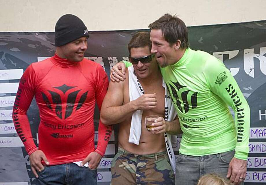 "Anthony Tashnick, left, and Kenny ""Skindog"" Collins, right, congratulate Dave Wassell as Wassell wins the Jay Moriarity Award at the 2009/2010 Surfers Mavericks Surf Contest in Half Moon Bay, Calif. on Saturday, Feb. 13, 2010. Photo: Adam Lau, The Chronicle"