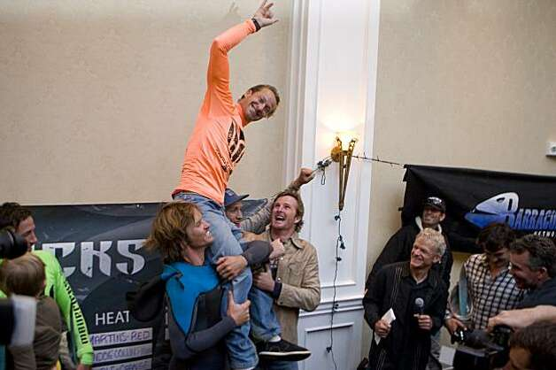 South African surfer Chris Bertish is hoisted onto fellow surfers shoulders before accepting first place in the Mavericks Surf Contest Surfers in Half Moon Bay, Calif. on Saturday, Feb. 13, 2010. Photo: Adam Lau, The Chronicle