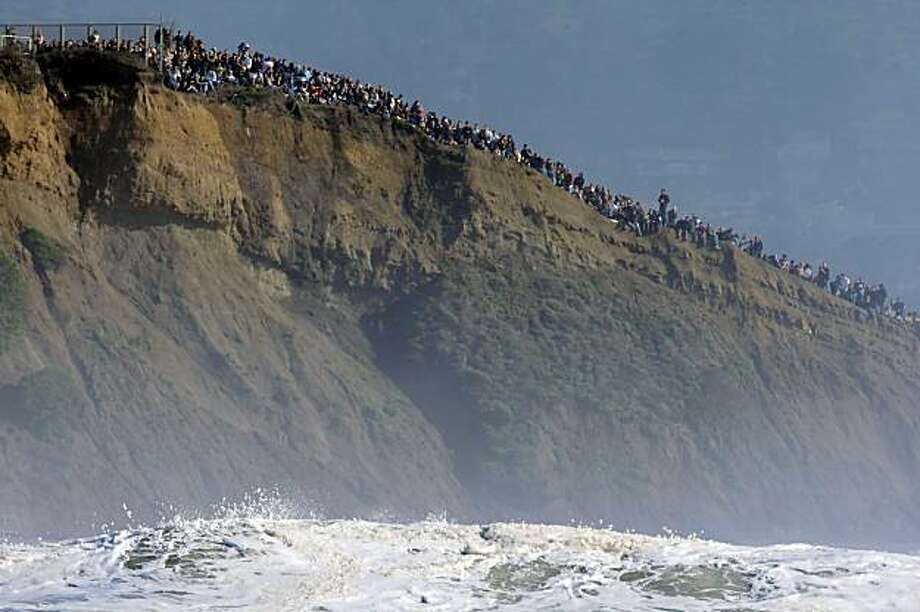 Spectators lined the seaside cliffs to get a view of the Mavericks Surf Contest. Surfers from around the globe braved the 50-foot-high swells at Mavericks Surf Contest in Half Moon Bay, Calif., on Saturday, February 13, 2010. Chris Bertish of South Africa was selected the winner. Photo: Carlos Avila Gonzalez, The Chronicle