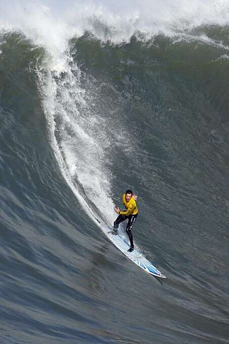 Kenny Collins rides a wave in the third heat. Surfers from around the globe braved the 50-foot-high swells at Mavericks Surf Contest in Half Moon Bay, Calif., on Saturday, February 13, 2010. Chris Bertish of South Africa was selected the winner. Photo: Carlos Avila Gonzalez, The Chronicle