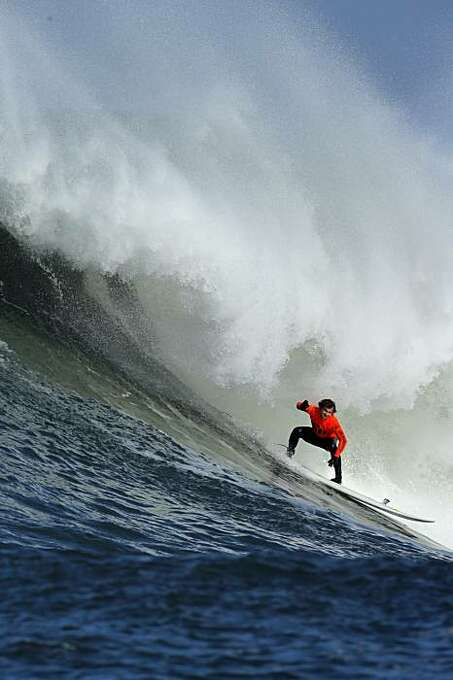 Carlos Burle rides a wave in the third heat. Surfers from around the globe braved the 50-foot-high swells at Mavericks Surf Contest in Half Moon Bay, Calif., on Saturday, February 13, 2010. Chris Bertish of South Africa was selected the winner. Photo: Carlos Avila Gonzalez, The Chronicle