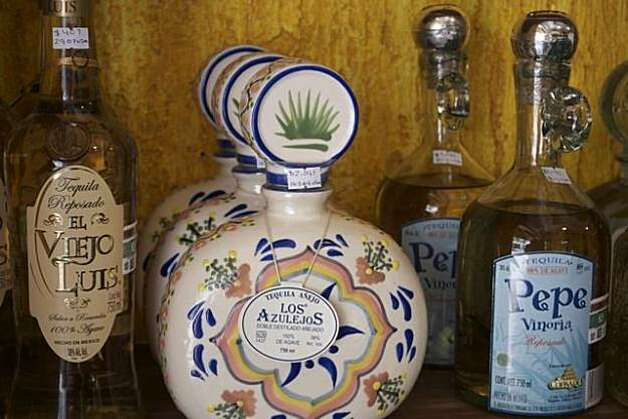 Hand-painted Los Azulejos bottles sell for $150 and more. Photo: Maribeth Mellin
