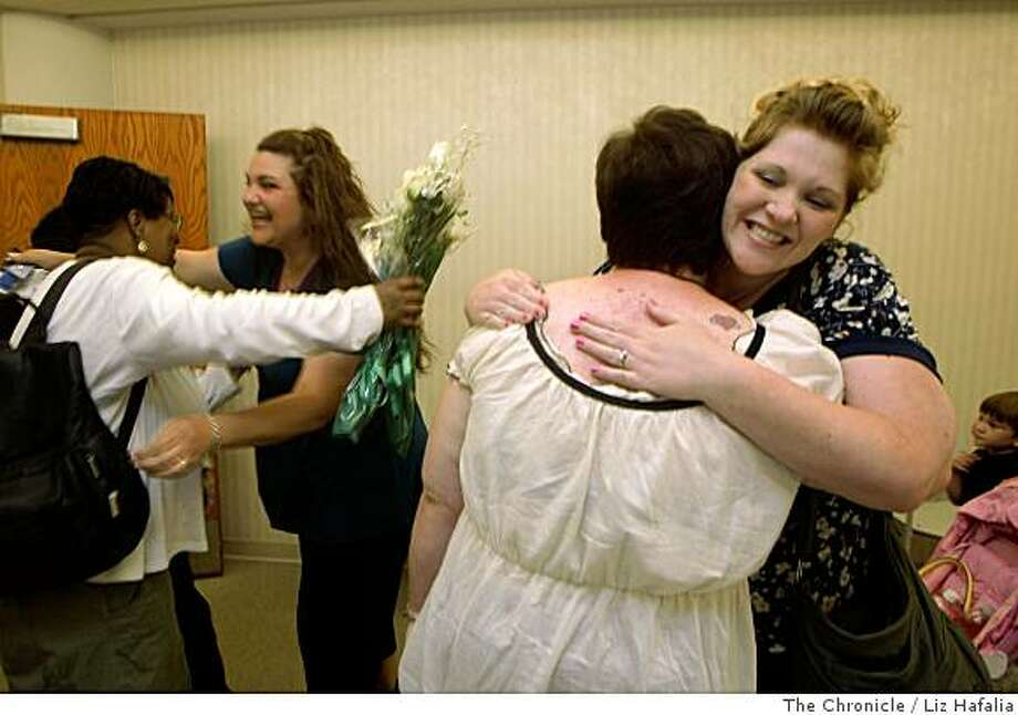 Tina Coulbertson (far left) gets a hug from Patricia Calhoun (left, green shirt), as Jennifer Lengyel (right,white shirt), gets a hug from Andrea Wood (flowered shirt) at the San Jose county chapel in San Jose, Calif., on Tuesday, June17,2008.  Tina Coulbertson and Jennifer Lengyel get married after knowing each other for 11 years and being domesticate partners for 7 years.Photo by Liz Hafalia/The Chronicle Photo: Liz Hafalia, The Chronicle