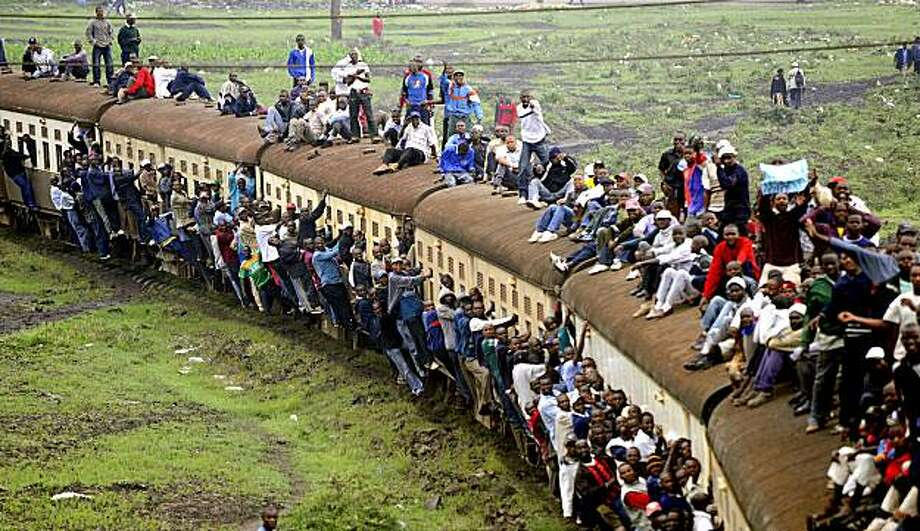 Kenyan passengers hang onto an overloaded train on January 5, 2010 in Nairobi after public transport was paralyzed in the main Kenyan cities as minibus taxi drivers went on a three-day strike following claims of extortion and corruption by Kenyan police. Thousands of workers who rely on the so-called matatus (minibuses) were forced to stay home. Others walked for hours or hitchhiked to work. Officials of the two lobby groups that have called the countrywide bus strike are set to meet Internal Security minister Prof George Saitoti later today in an attempt to end the paralyzing protest. Photo: Simon Maina, AFP / Getty Images