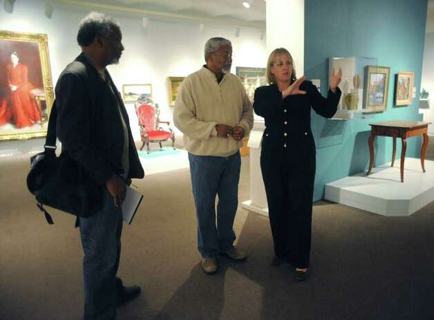 Dr. Leo Edwards, left, and his brother, Anthony Edwards, discuss an exhibit of African-American art with Katie Luber, director of the San Antonio Museum of Art, on Thursday, Nov. 10, 2011.  BILLY CALZADA / gcalzada@express-news.net Photo: BILLY CALZADA, SAN ANTONIO EXPRESS-NEWS / gcalzada@express-news.net