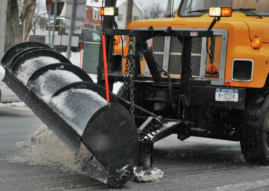 A state DOT snowplow in Colonie Thursday Jan. 12, 2012.    (John Carl D'Annibale / Times Union) Photo: John Carl D'Annibale / 10016078A