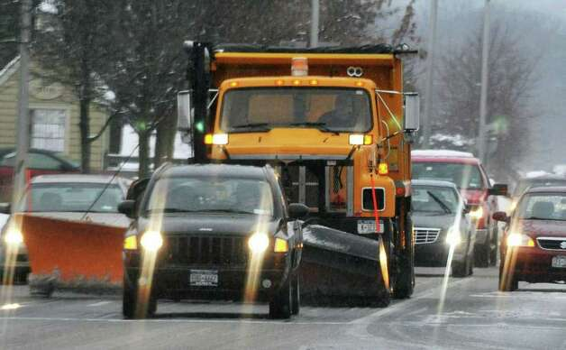 A state DOT snowplow takes its place in Colonie traffic Thursday Jan. 12, 2012.    (John Carl D'Annibale / Times Union) Photo: John Carl D'Annibale / 10016078A