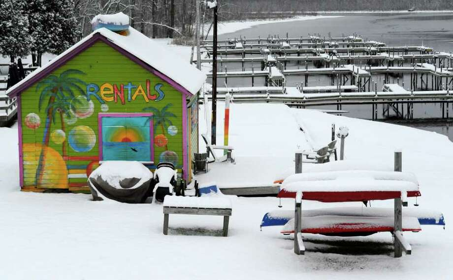 Snow covers some of the boats used for rentals in better weather on the north shore of Saratoga Lake  Jan, 11, 2012.  (Skip Dickstein / Times Union) Photo: SKIP DICKSTEIN / 2011