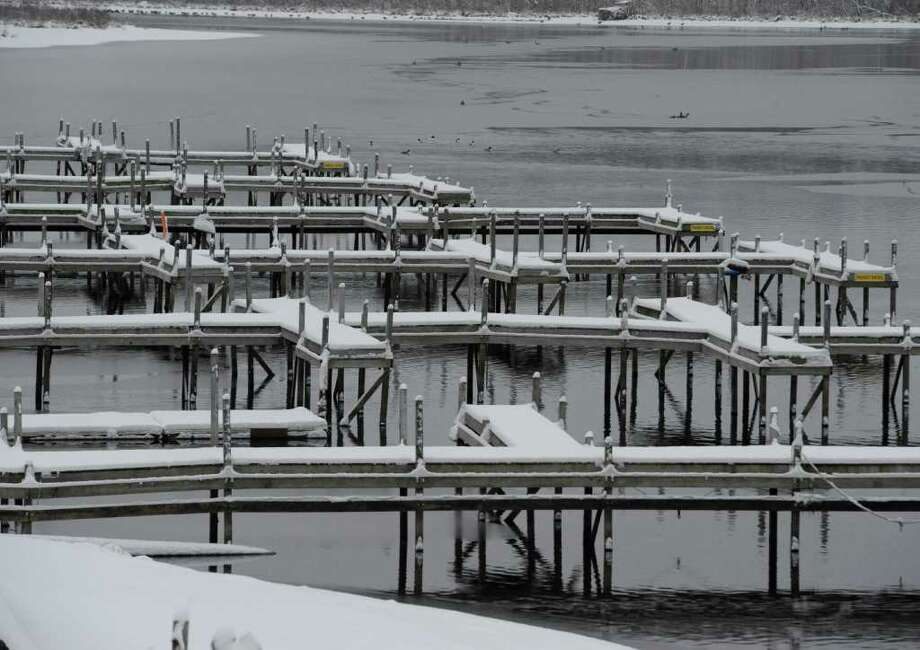 Unusually warm weather has left the Saratoga Lake with little ice covering as docks are covered with snow on the north shore of Saratoga Lake  Jan, 11, 2012.  (Skip Dickstein / Times Union) Photo: SKIP DICKSTEIN / 2011