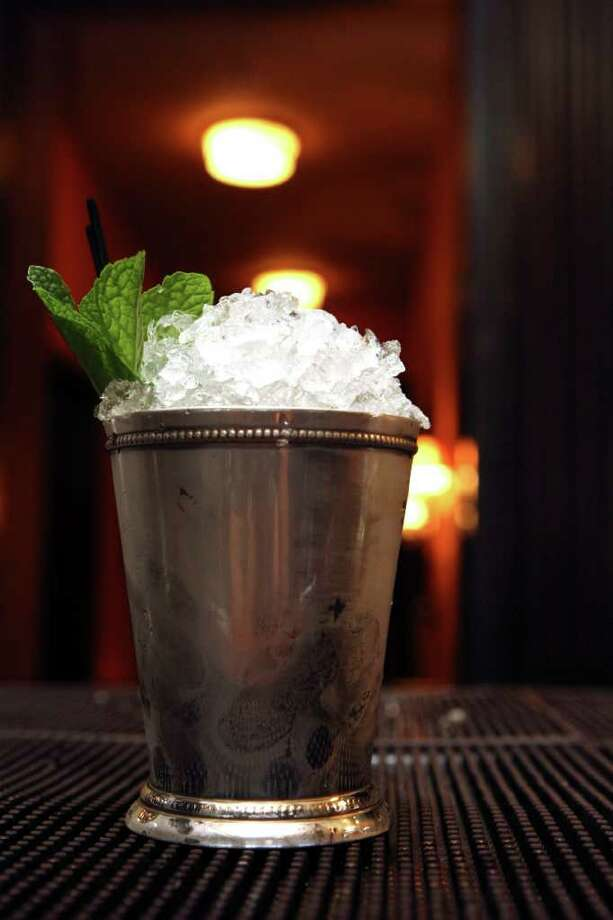 Jake Corney prepares a mint julep at Bohanan's on Friday Jan. 6, 2012.  Bohanan's has organized the San Antonio Cocktail Conference, the first of its kind for Texas. It's modeled after the Manhattan Cocktail Conference. Please shoot photos of bartenders mixing cocktails, the tools and ingredients they use, such as shakers, large format ice, etc. Photo: HELEN L. MONTOYA, San Antonio Express-News / SAN ANTONIO EXPRESS-NEWS