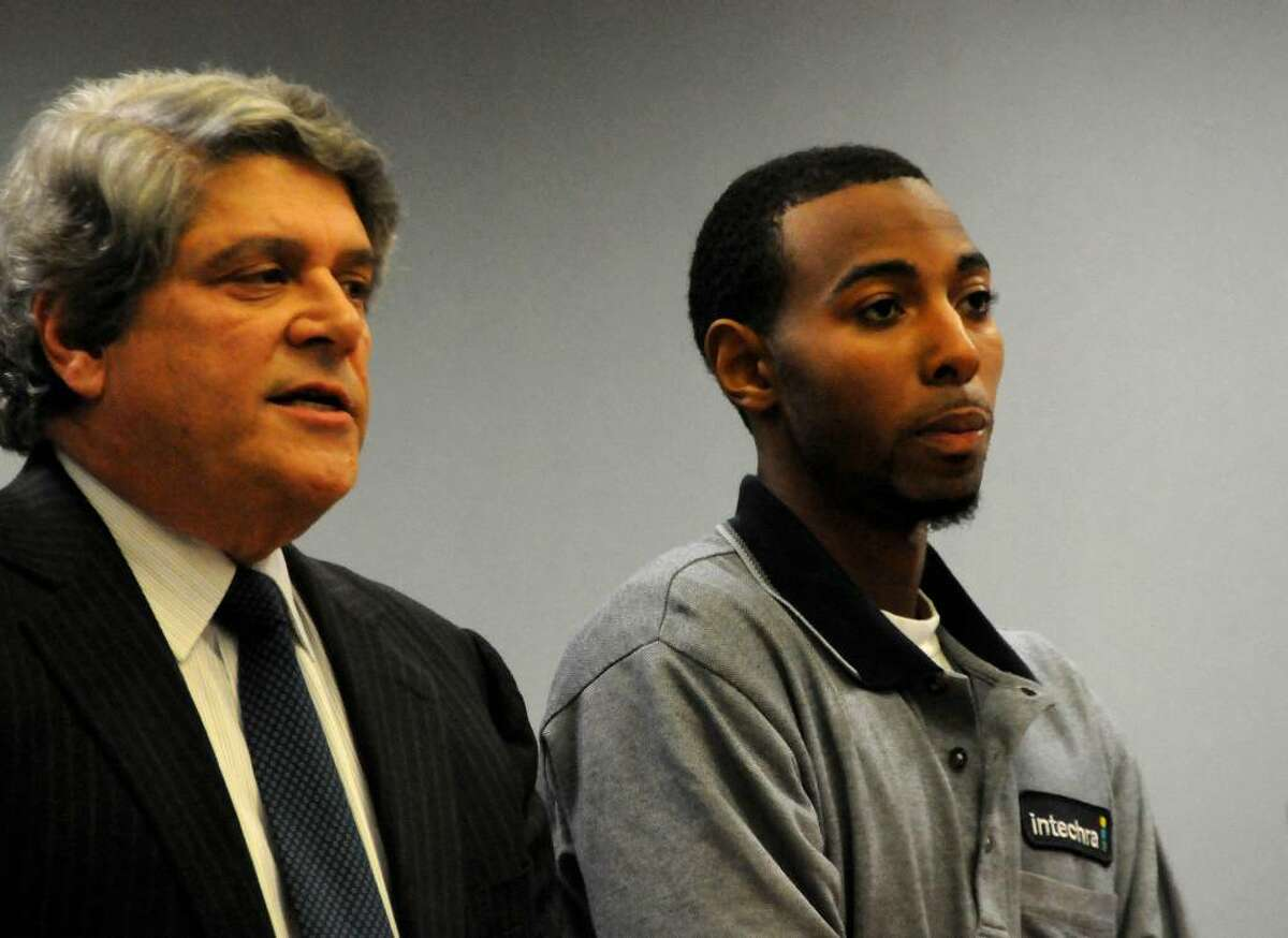 Hakim Muhammad, right, accompanied by Attorney Gerald Klein, is arraigned on charges connected with the slaying of UConn football star Jasper Howard, in a courtroom at Rockville Superior Court, in Rockville, Conn., on Wednesday, Oct. 28, 2009. (AP Photo/George Ruhe)