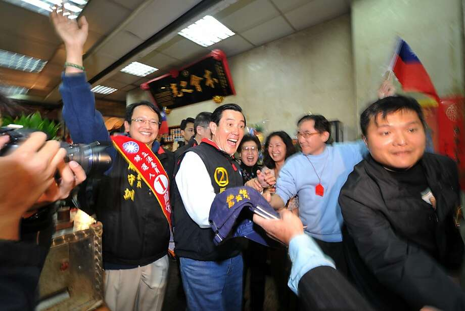 Taiwan President and ruling Kuomintang (KMT) presidential candidate Ma Ying-jeou (C) reacts as he greets a supporter at a store in a night market in Taipei on January 12, 2012.  Taiwan President Ma Ying-jeou said ties with China are unlikely to change despite an imminent, once-in-a-decade generational change in Beijing.  AFP PHOTO / AARON TAM (Photo credit should read aaron tam/AFP/Getty Images) Photo: Aaron Tam, AFP/Getty Images