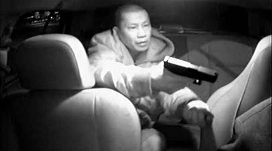 Seattle police released a photo taken inside of taxi showing a robbery suspect hold up a cab driver on Tuesday, Jan. 10 on Airport Way South.