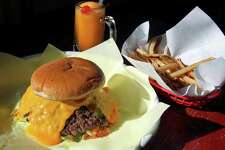 TASTE   Flaming Jalepe-0 burger with cheddar at Chris Madrid's  on January 10, 2012 Tom Reel/Staff