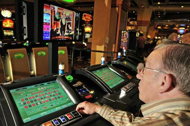 Douglas Miller, of Hudson Falls, plays one of the new electronic roulette machines at the Saratoga Gaming and Raceway Racino in Saratoga Springs, NY on September 24, 2010. (Lori Van Buren / Times Union) Photo: Lori Van Buren, Albany Times Union / 00010392A