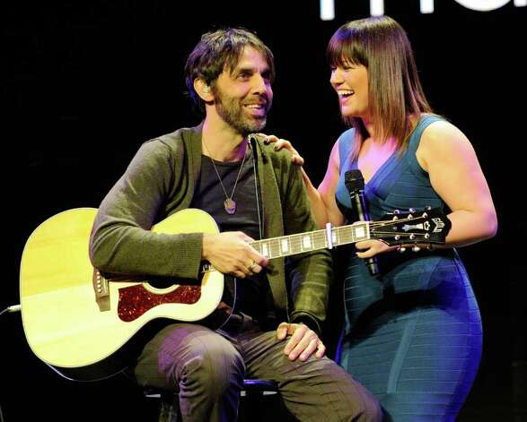 Guitarist Aben Eubanks (left) and singer Kelly Clarkson share a laugh after performing at a Sony Corp. press event at the Las Vegas Convention Center for the 2012 International Consumer Electronics Show January 9, 2012 in Las Vegas, Nevada. Photo: Ethan Miller, Getty Images / 2012 Getty Images