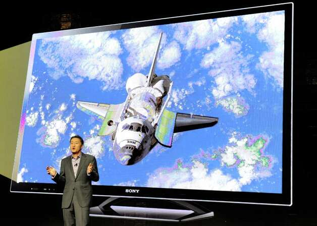 Sony Corp. Executive Deputy President Kazuo Hirai demonstrates Sony's X-Reality picture processing engine during a Sony press event at the Las Vegas Convention Center for the 2012 International Consumer Electronics Show January 9, 2012 in Las Vegas, Nevada. Photo: Ethan Miller, Getty Images / 2012 Getty Images