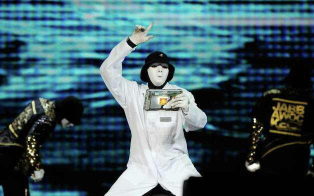 Members of the JabbaWockeez dance crew perform holding a tablet with the Qualcomm Snapdrogan processor during a keynote address by Chairman and CEO Dr. Paul E. Jacobs of Qualcomm at the 2012 International Consumer Electronics Show on January 10, 2012 in Las Vegas, Nevada. Photo: Kevork Djansezian, Getty Images / 2012 Getty Images