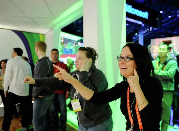 Adrienne Crompton (left) and Yvonne Isobell dance to Microsoft's Xbox 360's 'Dance Central 2' using the Kinect at the 2012 International Consumer Electronics Show at the Las Vegas Convention Center January 10, 2012 in Las Vegas, Nevada.  Photo: David Becker, Getty Images / 2012 Getty Images