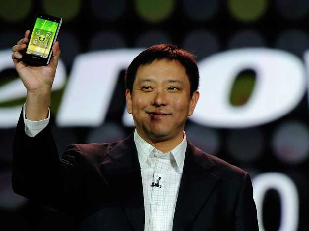 Senior vice president and president of Lenovo's Consumer Business Group Liu Jun shows the new Lenovo smartphone  during Intel's presentation at the 2012 International Consumer Electronics Show on January 10, 2012 in Las Vegas, Nevada.  Photo: Kevork Djansezian, Getty Images / 2012 Getty Images