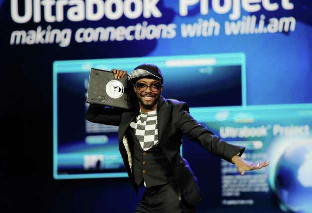 Recording artist and Intel's director of creative innovation will.i.am holds his Intel Ultrabook device during Intel's presentation at the 2012 International Consumer Electronics Show on January 10, 2012 in Las Vegas, Nevada. Photo: Kevork Djansezian, Getty Images / 2012 Getty Images