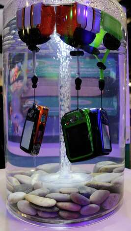 Fujifilm FinePix digital cameras are displayed in water to demonstrate that they are waterproof (up to to 32.8 feet) at the 2012 International Consumer Electronics Show at the Las Vegas Convention Center January 10, 2012 in Las Vegas, Nevada.  Photo: Ethan Miller, Getty Images / 2012 Getty Images