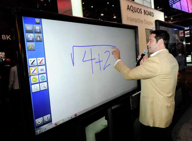 Tim Noonan demonstrates a Sharp Aquos Interactive Display System prototype on a 1080p full-HD, 70-inch LED/LCD display at the Sharp Electronics booth at the 2012 International Consumer Electronics Show at the Las Vegas Convention Center January 10, 2012 in Las Vegas, Nevada. Photo: Ethan Miller, Getty Images / 2012 Getty Images