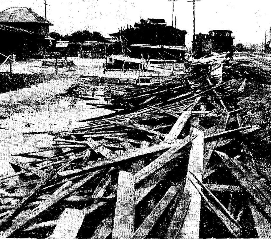 Lumber litters railroad tracks in San Antonio following a storm in 1936. Photo: Copyright 2006 Heritage Microfil, San Antonio Light Photo  / ALLEN HURRICANE