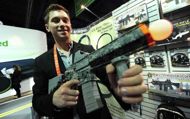 Jakub Ginda of CTA displays the US Army Elite Force Assault Rifle Controller for Playstation 3 and Playstation Move, at the International Consumer Electronics Show in Las Vegas, Nevada, on January 11, 2012. Photo: FREDERIC J. BROWN, AFP/Getty Images / 2012 AFP