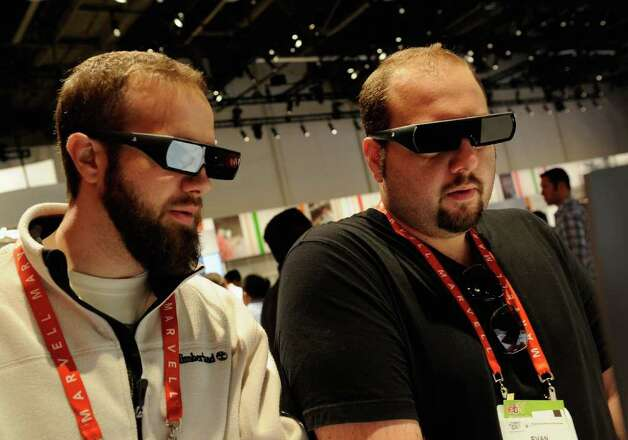 Convention attendees wearing 3D glass look at a screen in the Sony booth during the 2012 International Consumer Electronics Show at the Las Vegas Convention Center on January 11, 2012 in Las Vegas, Nevada. Photo: Kevork Djansezian, Getty Images / 2012 Getty Images