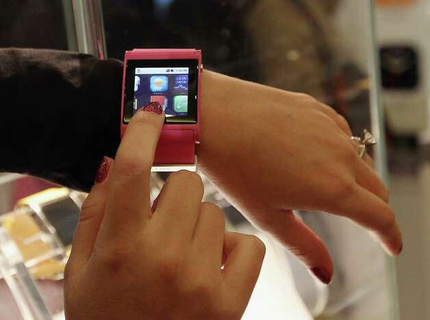 Bluetooth enabled watches that connect to your smartphone are on display from i'm watch of Italy at the 2012 International Consumer Electronics Show at the Las Vegas Convention Center January 11, 2012 in Las Vegas, Nevada. The product will be available in the second quarter of 2012.  Photo: Bruce Bennett, Getty Images / 2012 Getty Images