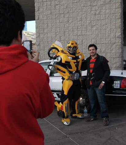 An attendee poses with a robotic figure outside the 2012 International Consumer Electronics Show at the Las Vegas Convention Center January 11, 2012 in Las Vegas, Nevada. Photo: Bruce Bennett, Getty Images / 2012 Getty Images