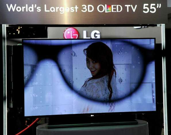 An LG 55-inch 3-D OLED TV is is partially seen through a pair of 3-D glasses at the LG Electronics booth at the 2012 International Consumer Electronics Show at the Las Vegas Convention Center January 11, 2012 in Las Vegas, Nevada.  Photo: Ethan Miller, Getty Images / 2012 Getty Images