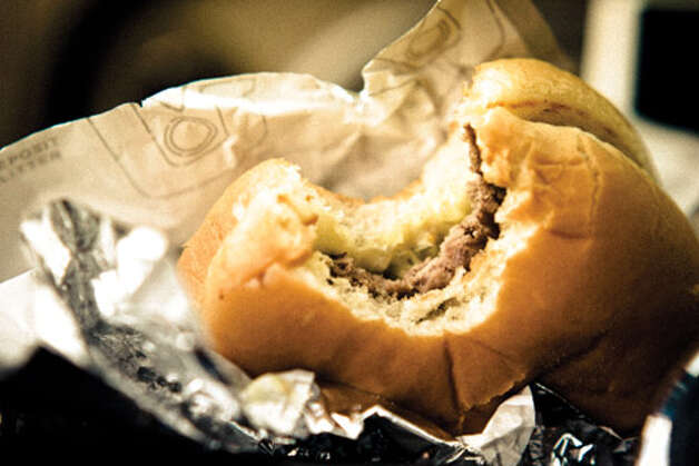 "Seattle's Classic Burgers: When the big city starts to feel cold and anonymous, the star-dotted ""I"" in Dick's retro orange sign promises a welcome return to old-school Seattle. You can count on affordable prices—a Dick's Deluxe ($2.70), extra-crisp fries ($1.50), hand-dipped shakes and root beer floats ($2.15)—and friendly faces working the counters. Open since January 1954, Dick's is doing something right: This fall they opened the sixth Dick's Drive-In in Edmonds. To see more of Seattle Magazine's picks for Seattle's Classic Burgers, click here for the list. Credit: Adam Reitano"