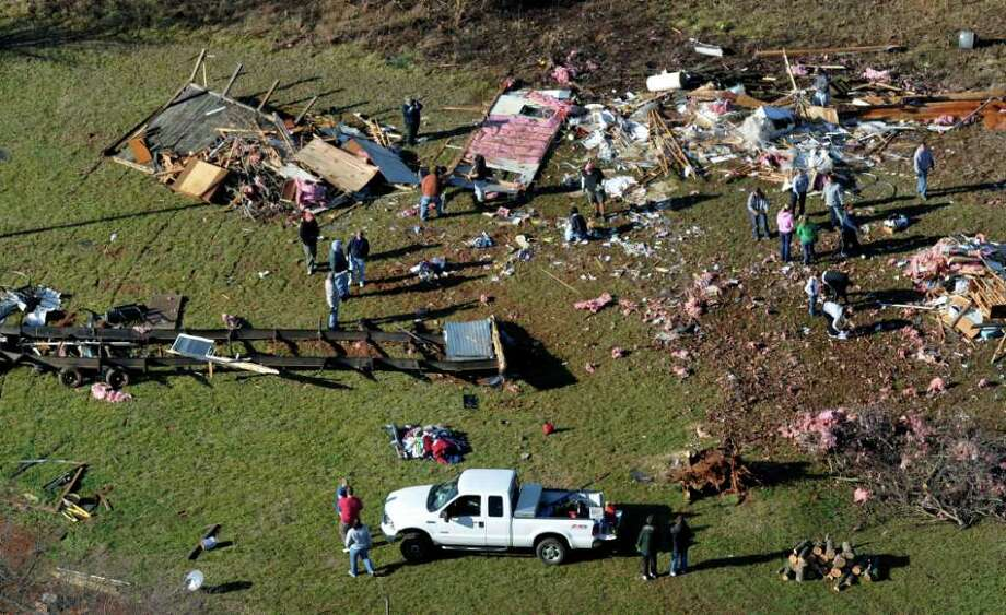 Debris covers the ground on Thursday in the town of Ellenboro, N.C. . At least 15 people were injured and at least 60 buildings damaged when a possible tornado struck in western North Carolina, the National Weather Service said Thursday.  The storms struck in Rutherford and Burke counties late Wednesday afternoon as a cold front moved through the western Carolinas, meteorologist Neil Dixon with the weather service office in Greer, S.C., said. Photo: AP