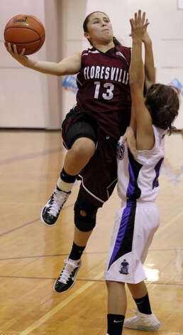 2011 action of Floresville girls basketball player Erica Hernandez. Photo: COURTESY PHOTO