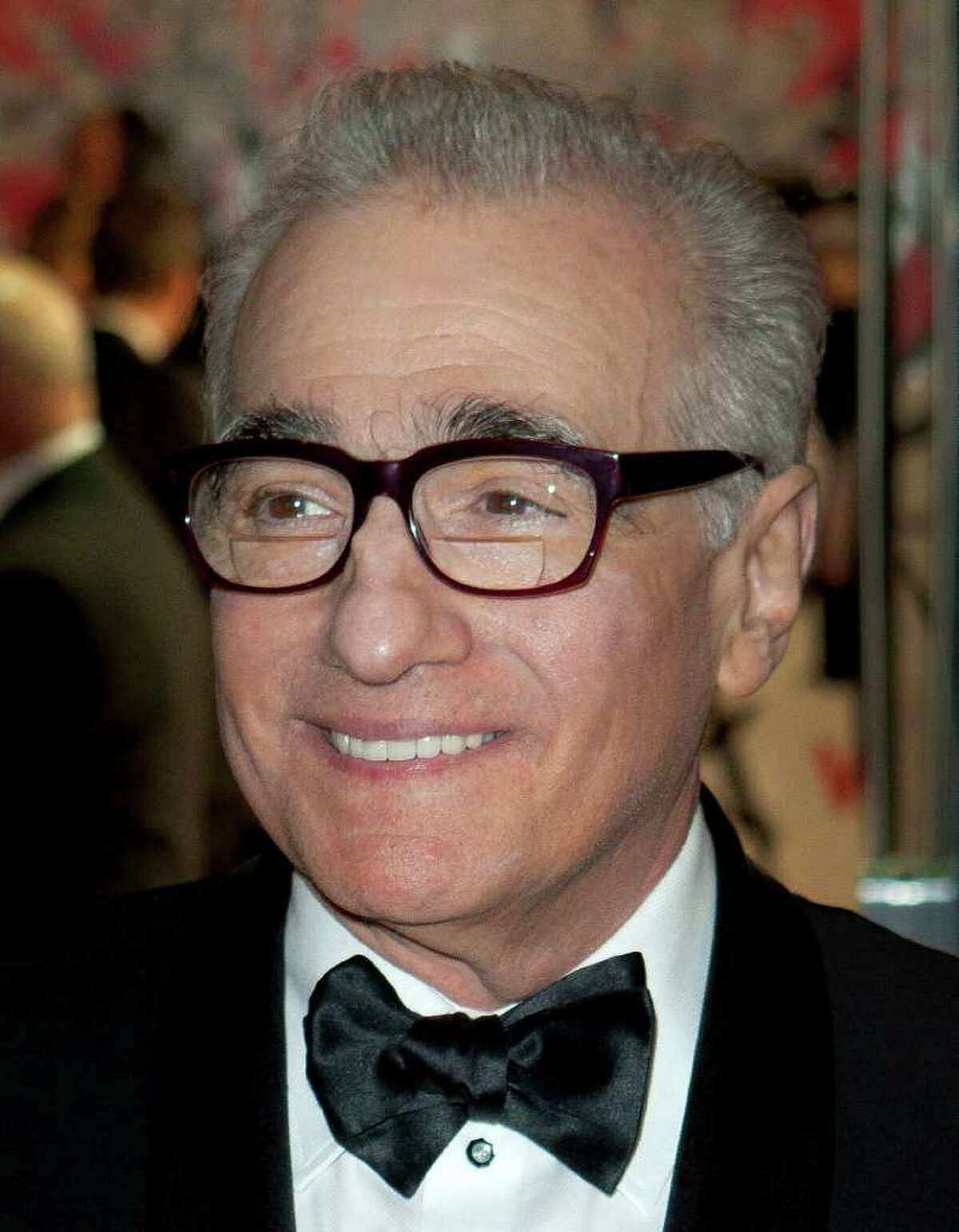 """FILE - In this Nov. 28, 2011 file photo, director Martin Scorsese arrives for the Royal Film Performance of """"Hugo,"""" in London. Scorsese was nominated Monday, Jan. 9, 2012 for the DGA Award for Outstanding Directorial Achievement in Feature Film for """"Hugo."""" Scorsese is also nominated for his documentary ?""""George Harrison: Living in the Material World.?"""" (AP Photo/Joel Ryan, file)"""