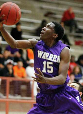 Taurean Waller-Prince shoots leads No. 2 Warren in points (21.9 per game) and rebounds (10.0). The Warriors are 22-4. Photo: Darren Abate, Darren Abate/Special To The Express-News