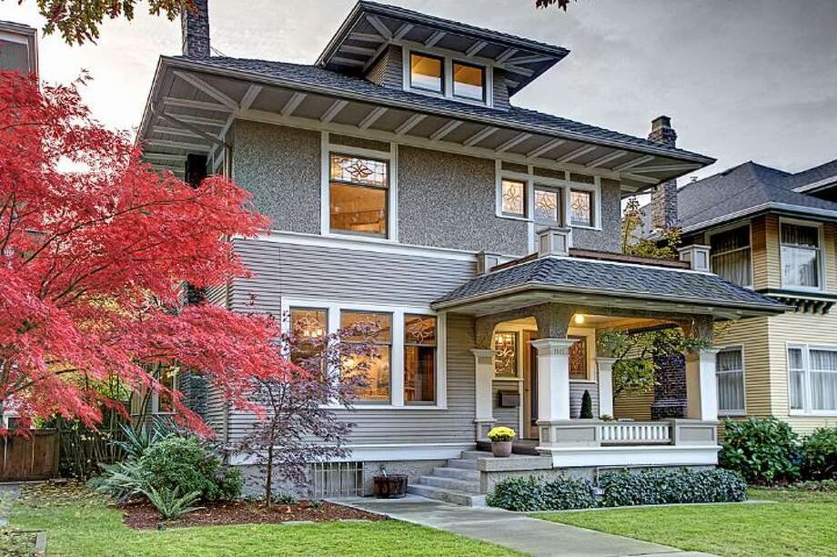 Here's a distinguished Capitol Hill Foursquare home built in 1908, at 1141 20th Ave. E. The 4,020-square-foot home has four bedrooms, 3.25 bathrooms, exposed-wood moldings, pillars and box beams, period fixtures, leaded glass and a finished basement, on a 4,320-square-foot lot. It's listed for $1.15 million. Photo: Brad Hinckley And Deirdre Doyle/Windermere Real Estate