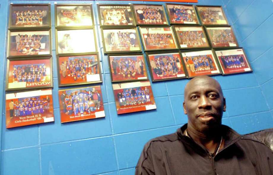 Lady Bruin's coach, Jessie White has photos of all the previous teams he coached in his office at West Brook in Beaumont, Wednesday, January 11, 2012. Tammy McKinley/The Enterprise Photo: TAMMY MCKINLEY