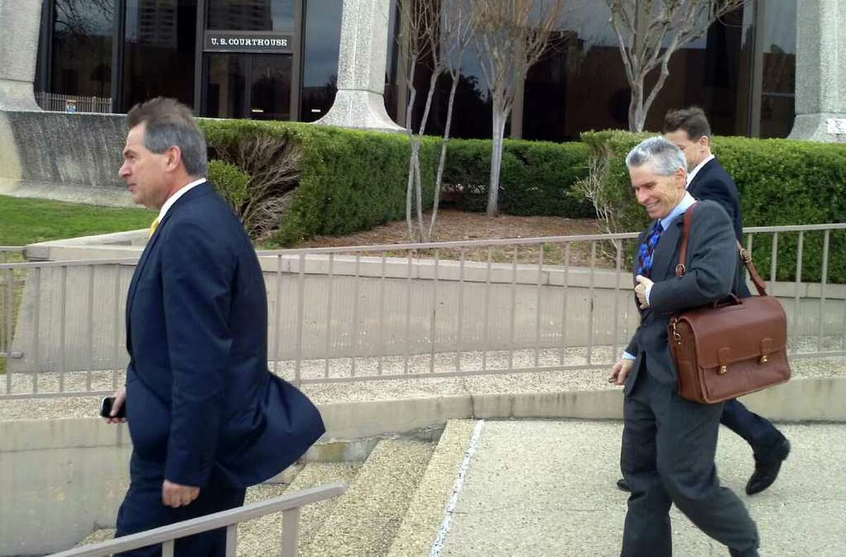 Kenneth Klug, head of intellectual property for Louis Vuitton (from left), leaves court with lawyers Harry Schafer and Charles Walker.